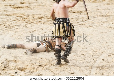 Killing, gladiator fighting in the arena of Roman circus - stock photo