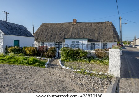 KILMORE QUAY, IRELAND - MAY 15, 2016: Inhabited traditional thatched cottage.