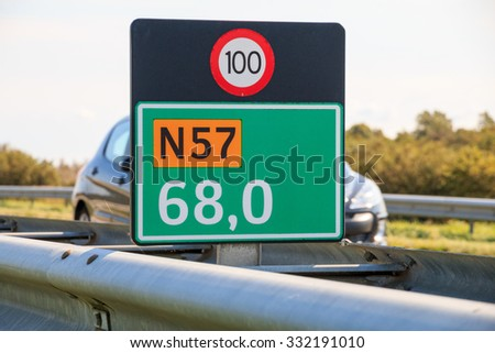Kilometer marker on the N57 road in the province of Zeeland, Netherlands - stock photo