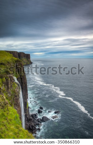 Kilt Rock Waterfall on The Isle of Skye, Scotland, United Kingdom on an overcast day. - stock photo