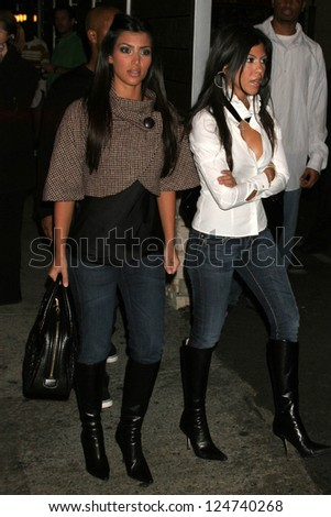 Kim Kardashian and friend at the Genetic Denim Party. Area, Hollywood, California. November 9, 2006.