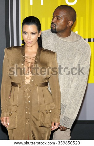 Kim Kardashian and Kanye West at the 2015 MTV Video Music Awards held at the Microsoft Theatre in Los Angeles, USA on August 30, 2015.  - stock photo
