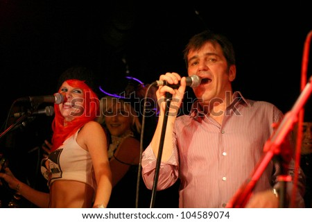 "Kim ""Mickey"" Enlow and Harry Bridgen at the Harry The Dog Concert. Viper Room, West Hollywood, CA. 08-08-09"