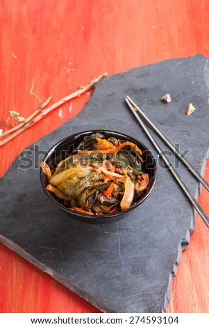 Kimchi / Salad of korean food traditional /Korean cabbage kimchi with hot pepper  isolate on red background  - stock photo