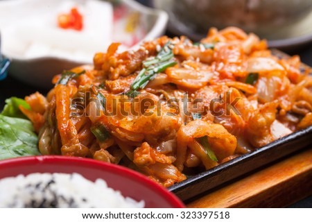 kimchi stir fried with pork meat in the restaurant - stock photo