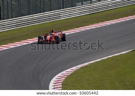Kimi Raikkonen taking corner at the Spa Francorchamps track in Belgium - stock photo