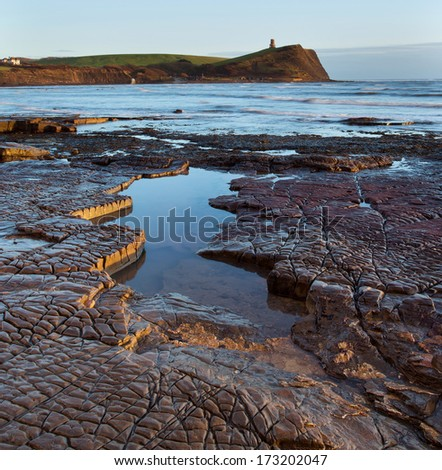 Kimmeridge, Dorset, UK -, Rock ledges and tidal pool at low tide in late afternoon winter sunshine