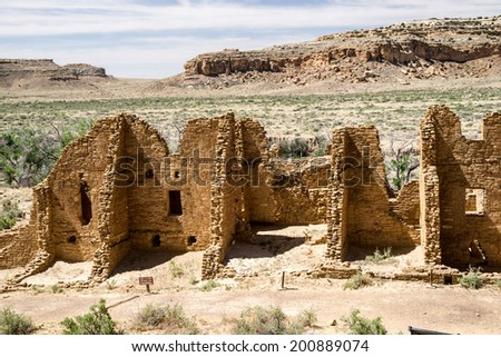 Kin Kletso pueblo at Chaco Canyon seen from the cliff side trail. - stock photo