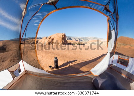 Kind early in the morning of the tent on a stone plateau. Grand Staircase-Escalante National Monument, Utah - stock photo
