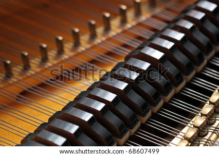 Kind on a grand piano from within - stock photo