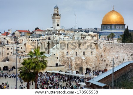 Kind on a Western Wall and on a the Dome of the Rock, Jerusalem, Israel - stock photo