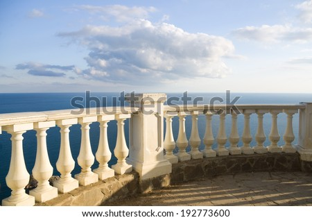 Kind on ocean from a stone balcony - stock photo