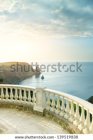 Kind on sea from a stone balcony - stock photo