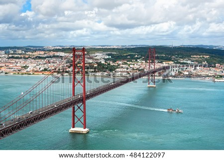 Kind on the river Tagus and the bridge of a name on April, 25, Lisbon (Lisboa), Portugal