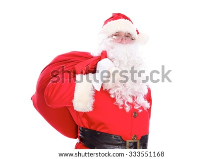 Kind Santa Claus carrying big bag, isolated on white background - stock photo