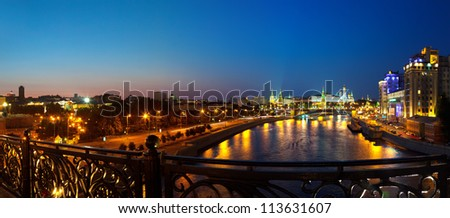 Kind to the Moscow Kremlin  and   Moskva River in night. Russia