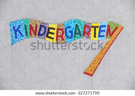 kindergarten colorful sign, symbol for childcare and child-friendliness - stock photo