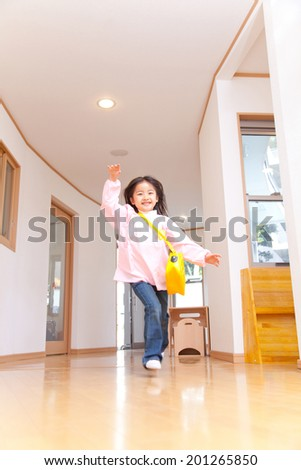 Kindergarten girls running in the corridor