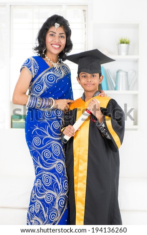 Kindergarten graduation. Asian Indian family, mother and son on kinder graduate day. - stock photo