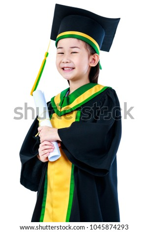 Kindergarten Graduation Happy Asian Child In Gown And Cap Holding Diploma Certificate At Studio