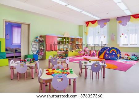 Kindergarten room with toys. - stock photo