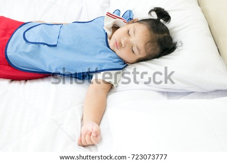 Kindergarten students sleep. While still wearing school uniforms because of tired of activities while at school.Photography in the concept of children sleep.