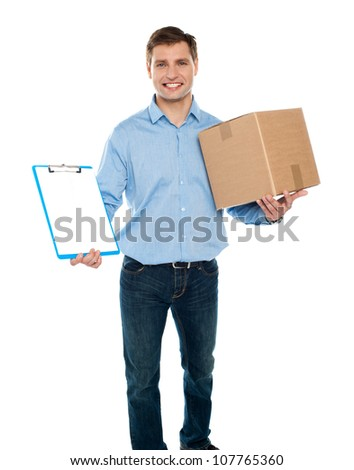 Kindly accept the delivery. Courier services. Man holding clipboard and carton - stock photo
