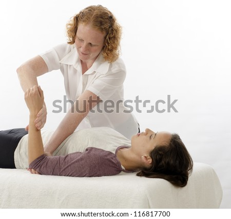 Kinesiologist or physiotherapist treating Brachioradialis - stock photo