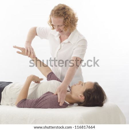 Kinesiologist or physiotherapist treating Diaphragm - stock photo