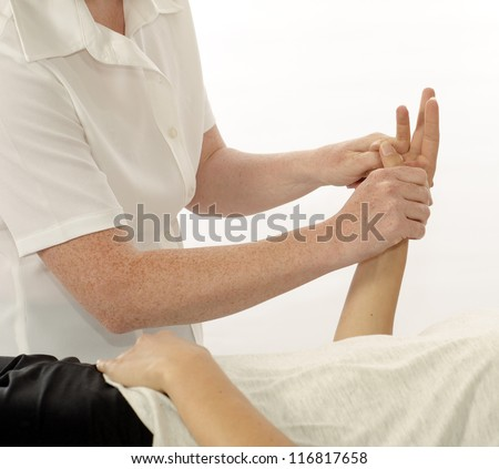 Kinesiologist or physiotherapist treating hand opponens pollicis - stock photo