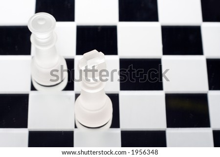 King and Queen on a chess board - stock photo