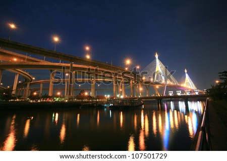 King Bhumibol, industrial ring road, bridge with ferry port and floodgate at night in Bangkok, Thailand