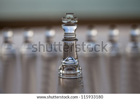 King chess piece, pawns behind, business concept series: - strategy, CEO, leadership, strength, business mentor, coaching, guru, success. Text / copy space, business card design. - stock photo