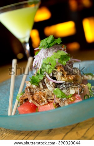 king crab tempura, served with red onion, watermelon, garnish and finished off with a drizzle of tangy amazu ponzu sauce - stock photo