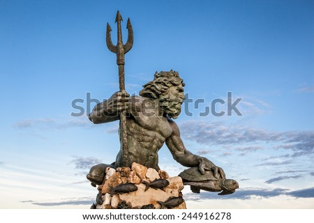 King Neptune statute, famous tourist attraction at Virginia Beach against a blue sky in summer - stock photo