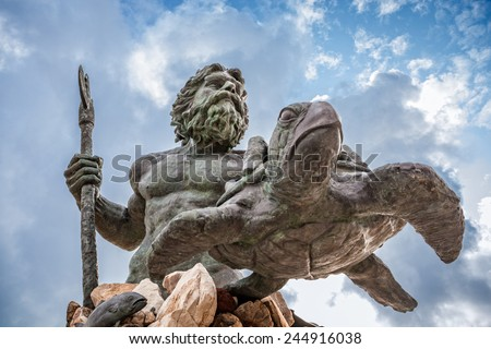 King Neptune statute, famous tourist attraction at Virginia Beach, against a cloudy sky - stock photo