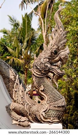 King of naga statue in thai temple - stock photo