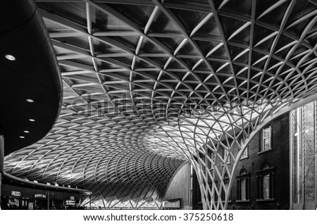 King's Cross London railway station indoor modern architecture construction, contrast with the old house - stock photo