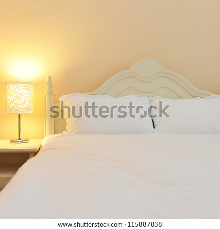 King size bed in modern living room. - stock photo