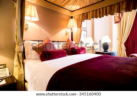 King size neat double bedroom - stock photo