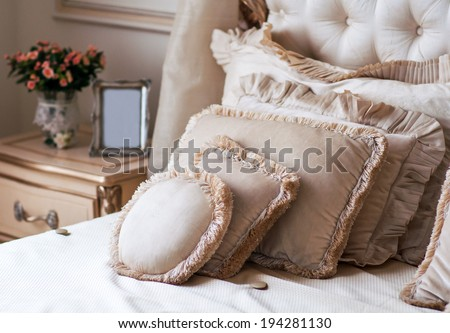 King sized bed in a business hotel room - stock photo