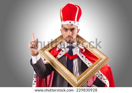 King with picture frame on white - stock photo