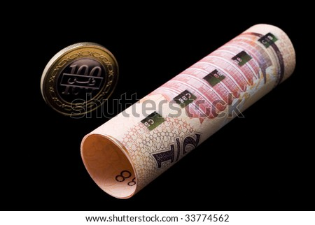 Kingdom of Bahrain currency banknote roll and coin - stock photo