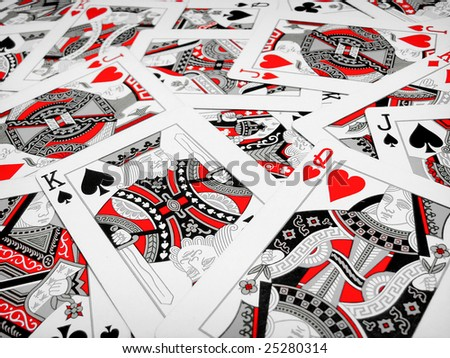 Kings queens and jacks playing cards scattered - stock photo