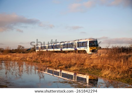 KINGS SUTTON, UK - JANUARY 19: A Chiltern Railways commuter service train passes Kings Sutton on route to London on January 19, 2015 in Kings Sutton. Chiltern operate a fleet of 87 units over 336Km  - stock photo