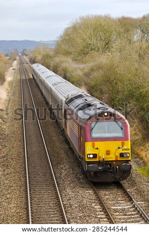KINGSEY, UK - JANUARY 30: Chiltern Railways operated express The Businessman, passes Kingsey bridge on January 30, 2015 in Kingsey. Chiltern operate a fleet of 87 power units calling at 62 stations