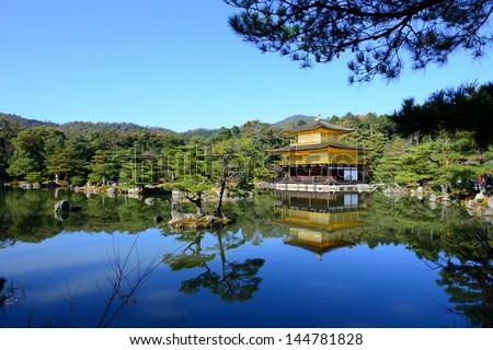 Kinkakuji Temple (The Golden Pavilion) in Kyoto, Japan and its surrounding beautiful park - stock photo