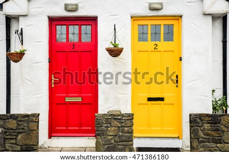 KINSALE, IRELAND: MAY 25, 2014: Brightly colored doors mark the entrance to homes in the seaside town of Kinsale, County Cork, Ireland