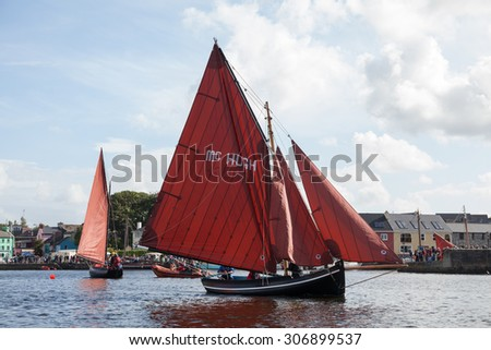 KINVARA, IRELAND - AUGUST 15: Traditional wooden boats Galway Hooker compete in the race during anual Gathering of the Boats festival on August 15, 2015, in Kinvara, Ireland.