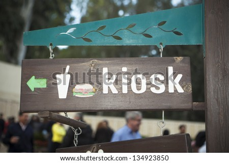 Kiosk sign with a hamburger made of carved wood - stock photo